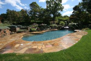 Pugliese Pools Traditional pool custom landscaping